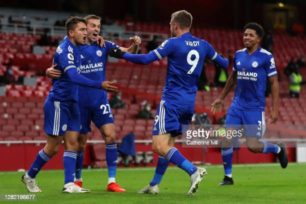 Jamie Vardy of Leicester City celebrates with teammates Timothy Castagne Cengiz Uender and Wesley Fofana of Leicester City after scoring his team's...