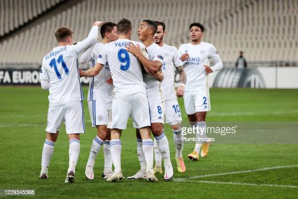 Jamie Vardy of Leicester City celebrates with Youri Tielemans of Leicester City and his team mates after scoring from the penalty spot to make it 01...