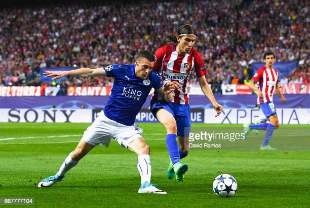 Jamie Vardy of Leicester City challenges for the ball with Filipe Luis of Atletico Madrid during the UEFA Champions League Quarter Final first leg...