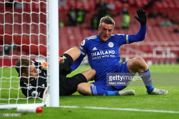 Jamie Vardy of Leicester City collides with Bernd Leno of Arsenal during the Premier League match between Arsenal and Leicester City at Emirates...