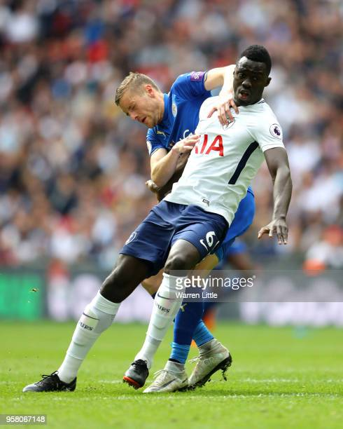 Jamie Vardy of Leicester City collides with Davinson Sanchez of Tottenham Hotspur during the Premier League match between Tottenham Hotspur and...