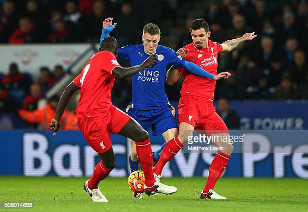 Jamie Vardy of Leicester City controls the ball against Dejan Lovren and Mamadou Sakho of Liverpool during the Barclays Premier League match between...