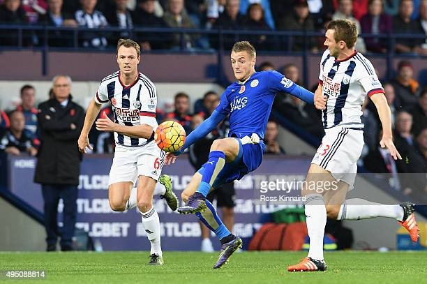 Jamie Vardy of Leicester City controls the ball against Jonny Evans and Gareth McAuley of West Bromwich Albion during the Barclays Premier League...