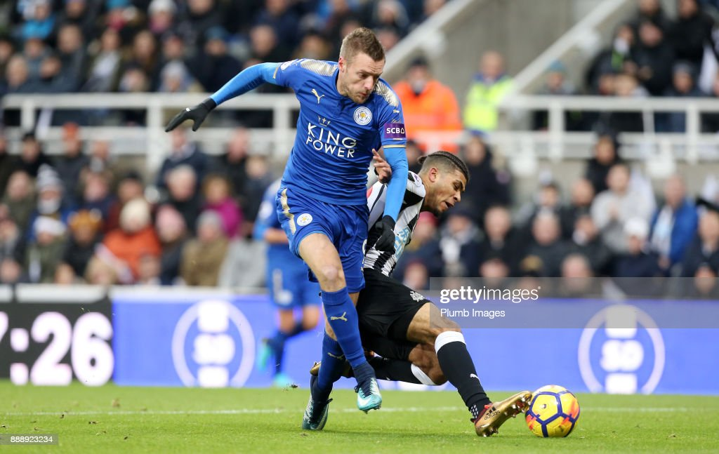 Jamie Vardy of Leicester City goes down in the box from a challenge by DeAndre Yedlin of Newcastle United during the Premier League match between Newcastle United and Leicester City at St. James Park on December 9th, 2017 in Newcastle Upon Tyne, United Kingdom
