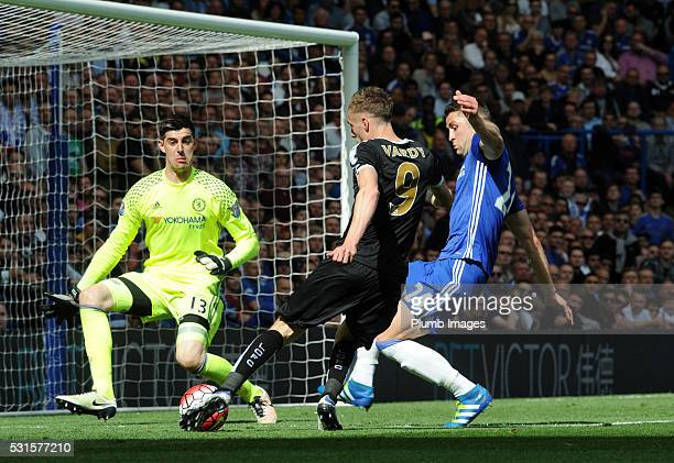 Jamie Vardy of Leicester City has a shot at Thibaut Courtois of Chelsea during the Premier League match between Chelsea and Leicester City at...