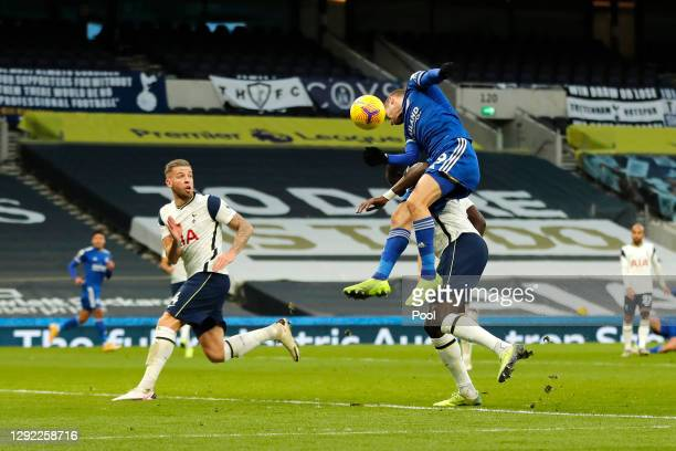 Jamie Vardy of Leicester City heads the ball into Toby Alderweireld of Tottenham Hotspur leading to him scoring an own goal during the Premier League...