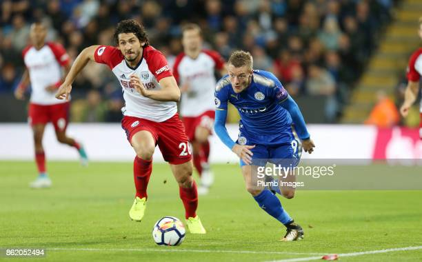 Jamie Vardy of Leicester City in action with Ahmed Hegazi of West Bromwich Albion during the Premier League match between Leicester City and West...
