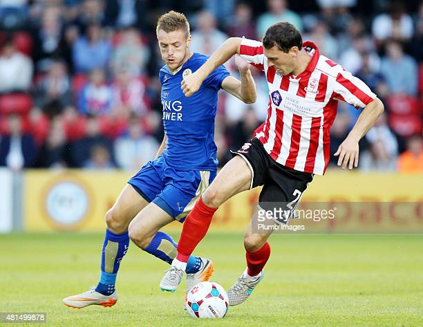 Jamie Vardy of Leicester City in action with Bradley Wood of Lincoln Cityl during the preseason friendly between Lincoln City and Leicester City at...