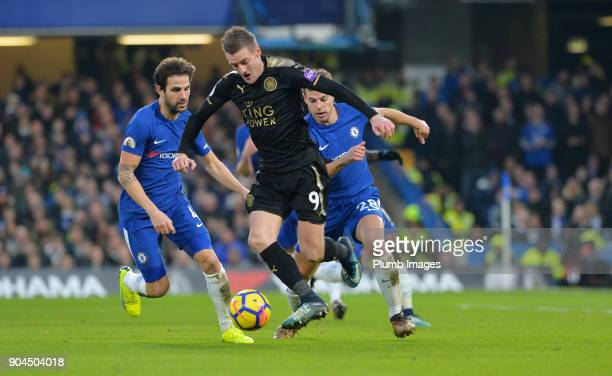 Jamie Vardy of Leicester City in action with Cesc Fabregas and Ceasr Azpilicueta of Chelsea during the Premier League match between Chelsea and...