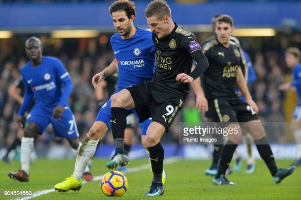 Jamie Vardy of Leicester City in action with Cesc Fabregas of Chelsea during the Premier League match between Chelsea and Leicester City at Stamford...