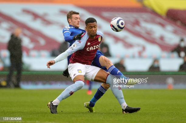 Jamie Vardy of Leicester City in action with Ezri Konsa of Aston Villa during the Premier League match between Aston Villa and Leicester City at...