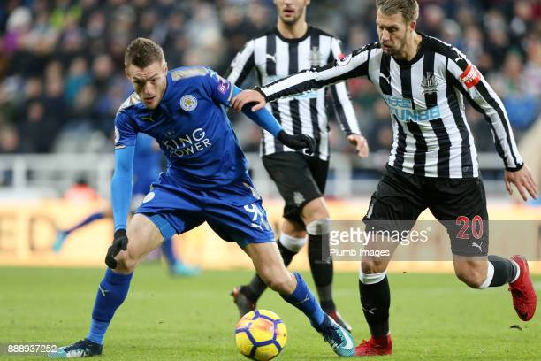 Jamie Vardy of Leicester City in action with Florian Lejeune of Newcastle United during the Premier League match between Newcastle United and...