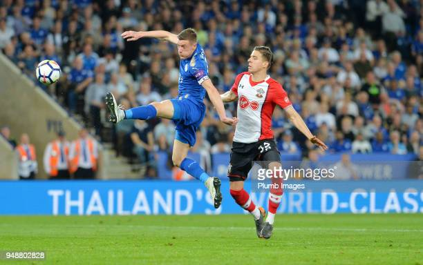 Jamie Vardy of Leicester City in action with Jan Bednarek of Southampton during the Premier League match between Leicester City and Southampton at...