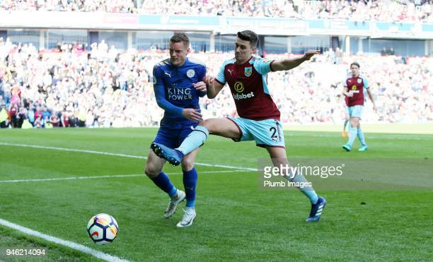 Jamie Vardy of Leicester City in action with Matthew Lowton of Burnley during the Premier League match between Burnley and Leicester City at Turf...