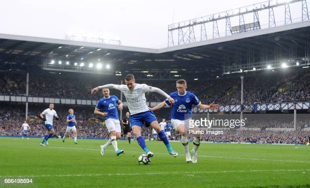 Jamie Vardy of Leicester City in action with Matthew Pennington of Everton during the Premier League match between Everton and Leicester City at...