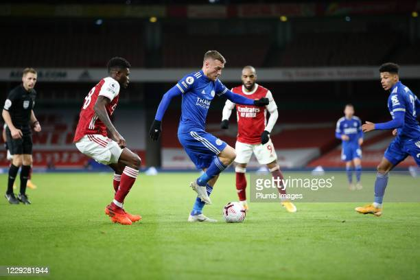 Jamie Vardy of Leicester City in action with Thomas Partey of Arsenal during the Premier League match between Arsenal and Leicester City at Emirates...