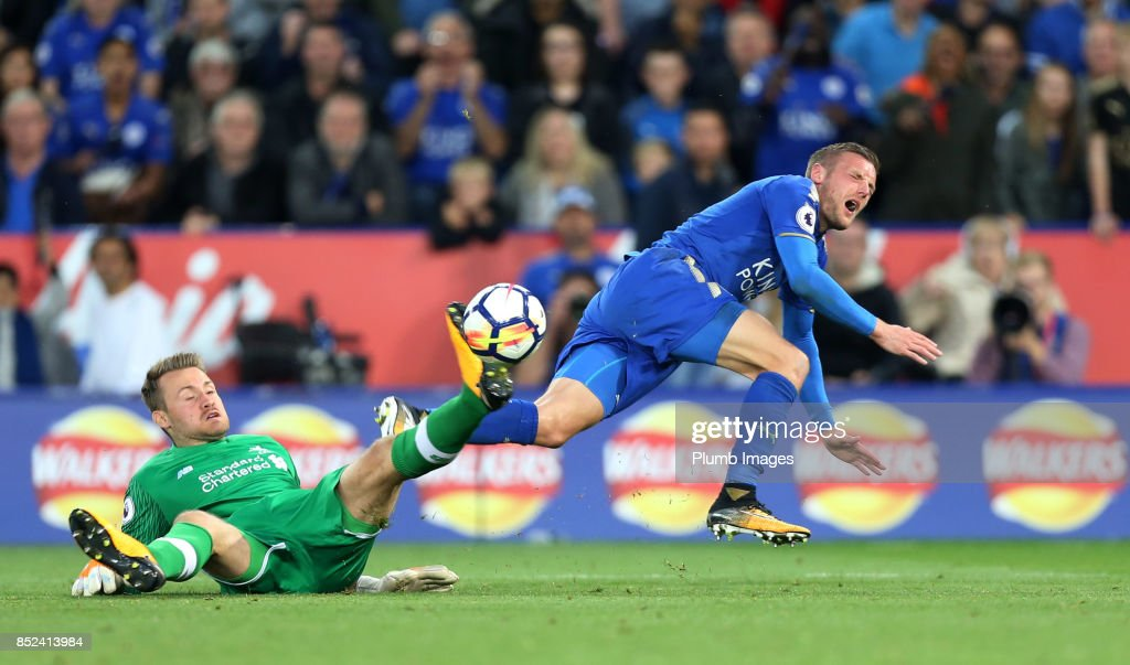 Jamie Vardy of Leicester City is brought down by Simon Mignolet of Liverpool resulting in a penalty during the Premier League match between Leicester City and Liverpool at King Power Stadium on September 23rd, 2017 in Leicester, United Kingdom.