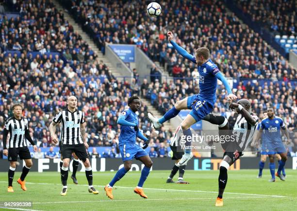Jamie Vardy of Leicester City is caught by Mohamed Diame of Newcastle United as he jumps for the ball during the Premier League match between...