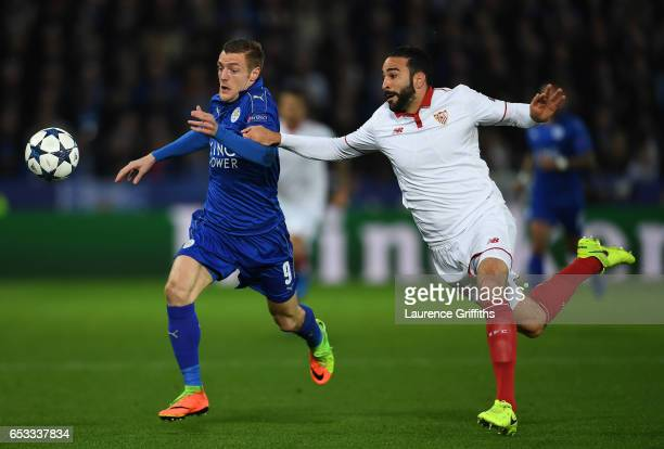 Jamie Vardy of Leicester City is challenged by Adil Rami of Sevilla during the UEFA Champions League Round of 16 second leg match between Leicester...