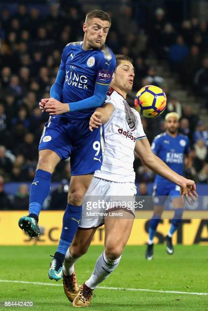 Jamie Vardy of Leicester City is challenged by James Tarkowski of Burnley during the Premier League match between Leicester City and Burnley at The...