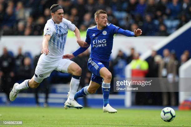 Jamie Vardy of Leicester City is challenged by Michael Keane of Everton during the Premier League match between Leicester City and Everton FC at The...