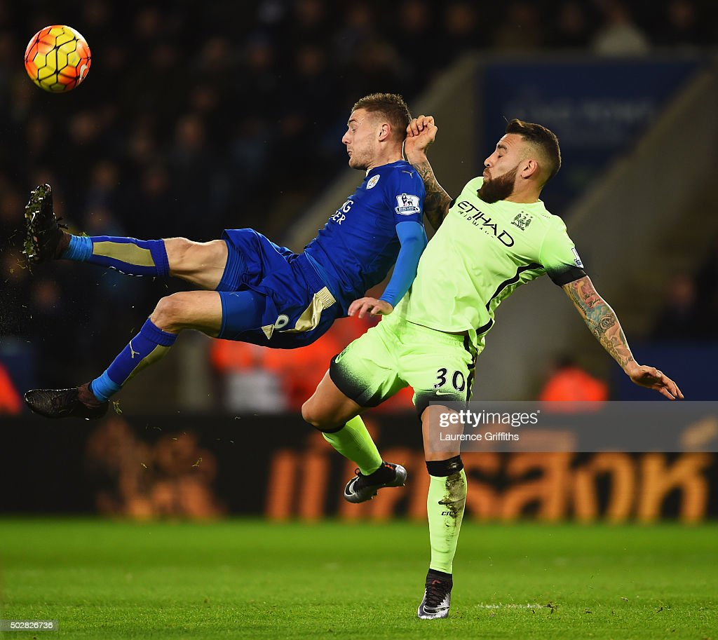 Jamie Vardy of Leicester City is challenged by Nicolas Otamendi of Manchester City during the Barclays Premier League match between Leicester City and Manchester City at The King Power Stadium on December 29, 2015 in Leicester, England.