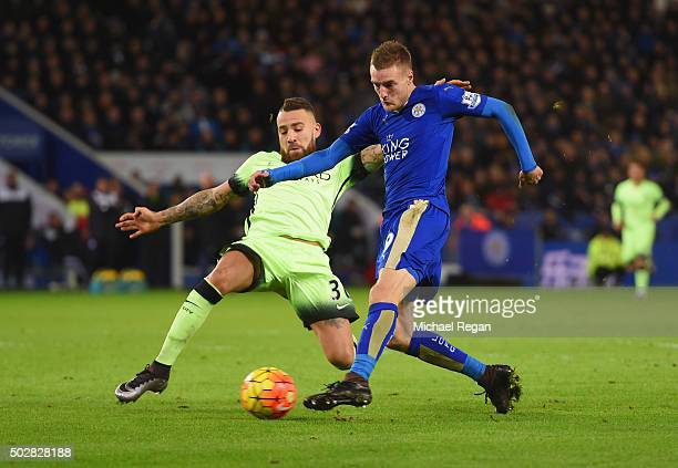 Jamie Vardy of Leicester City is challenged by Nicolas Otamendi of Manchester City as he shoots during the Barclays Premier League match between...