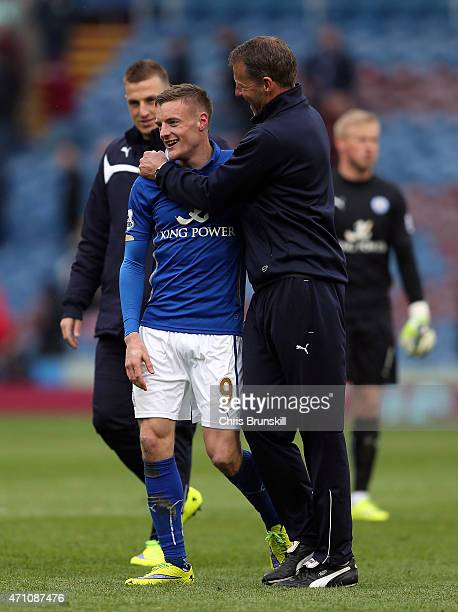 Jamie Vardy of Leicester City is congratulated at fulltime by a member of the coaching staff following the Barclays Premier League match between...