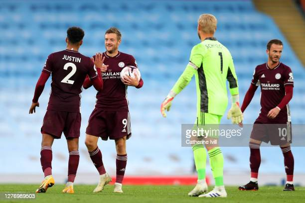 Jamie Vardy of Leicester City is congratulated by teammates after scoring a hat trick during the Premier League match between Manchester City and...