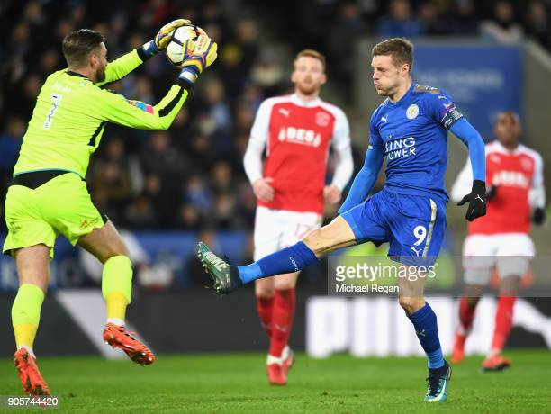 Jamie Vardy of Leicester City is foiled by Chris Neal of Fleetwood Town during The Emirates FA Cup Third Round Replay match between Leicester City...