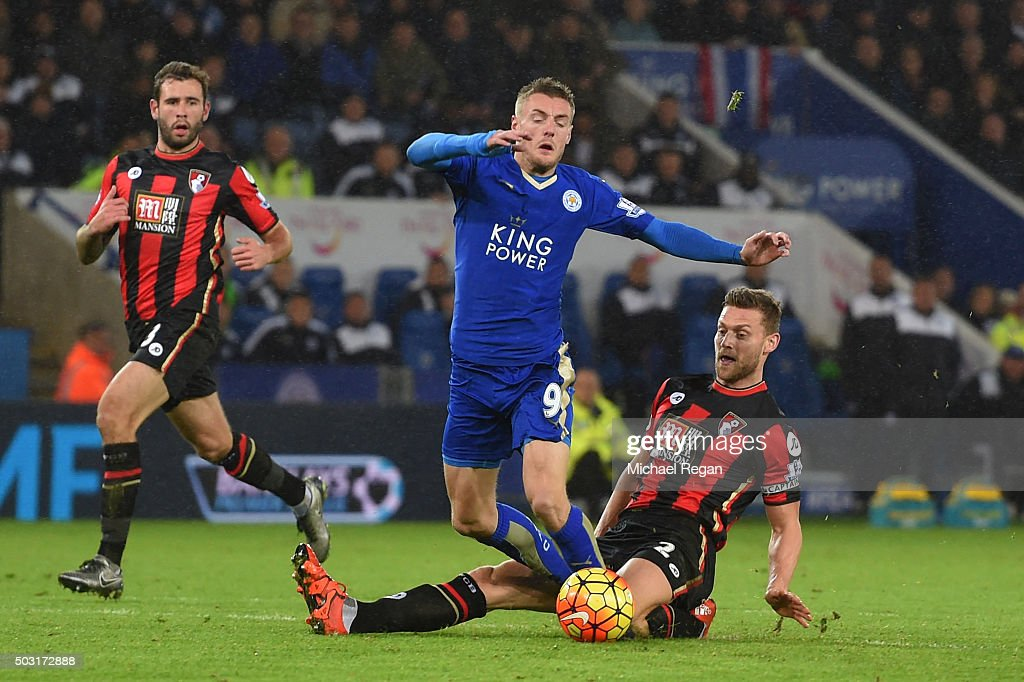 Jamie Vardy of Leicester City is fouled by Simon Francis of Bournemouth resulting in the penalty during the Barclays Premier League match between Leicester City and Bournemouth at The King Power Stadium on January 2, 2016 in Leicester, England.