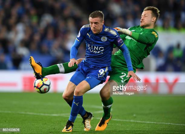 Jamie Vardy of Leicester City is fouled by Simon Mignolet of Liverpool and a penalty is awarded to Leicester City during the Premier League match...