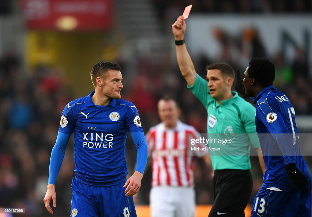 Jamie Vardy of Leicester City (L) is shown a red card by referee Craig Pawson during the Premier League match between Stoke City and Leicester City at Bet365 Stadium on December 17, 2016 in Stoke on Trent, England.