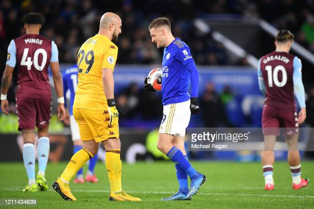 Jamie Vardy of Leicester City is spoken too by Goalkeeper Pepe Reina of Aston Villa before he scores a penalty during the Premier League match...