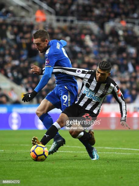 Jamie Vardy of Leicester City is tackled by Deandre Yedlin of Newcastle United during the Premier League match between Newcastle United and Leicester...
