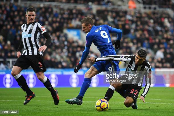 Jamie Vardy of Leicester City is tackled by Deandre Yedlin of Newcastle United as Ciaran Clark of Newcastle United looks on during the Premier League...