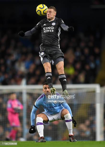 Jamie Vardy of Leicester City jumps for the ball infront of Nicolas Otamendi of Manchester City during the Premier League match between Manchester...