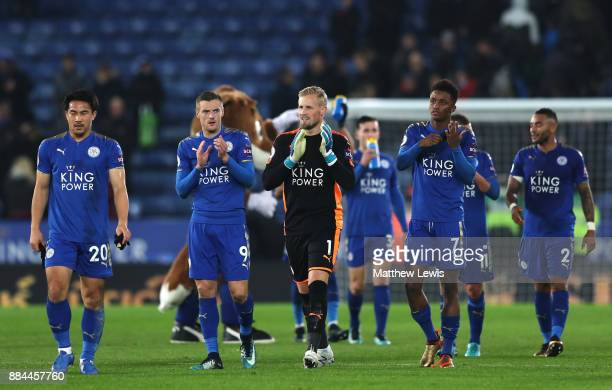 Jamie Vardy of Leicester City Kasper Schmeichel of Leicester City and Demarai Gray of Leicester City show appreciation to the fans after the Premier...