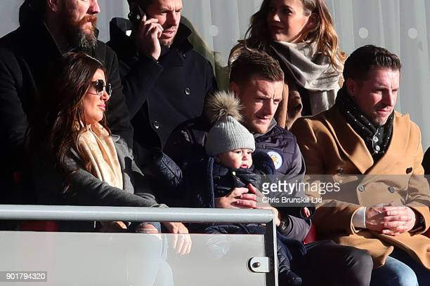 Jamie Vardy of Leicester City looks on from the stand next to his wife Rebekah holding his son Finlay during The Emirates FA Cup Third Round match...