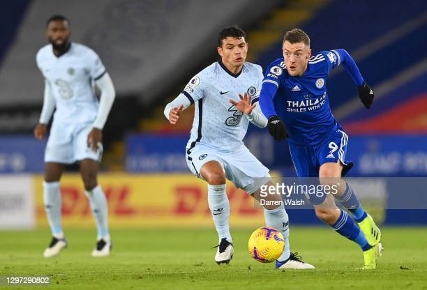 Jamie Vardy of Leicester City looks to break past Thiago Silva of Chelsea during the Premier League match between Leicester City and Chelsea at The...