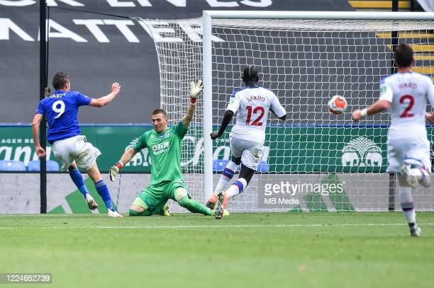 Jamie Vardy of Leicester City places the ball past Crystal Palace goalkeeper Vicente Guaita to score his second goal and his sides third during the...
