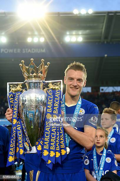Jamie Vardy of Leicester City poses with the Premier League Trophy after the Barclays Premier League match between Leicester City and Everton at The...