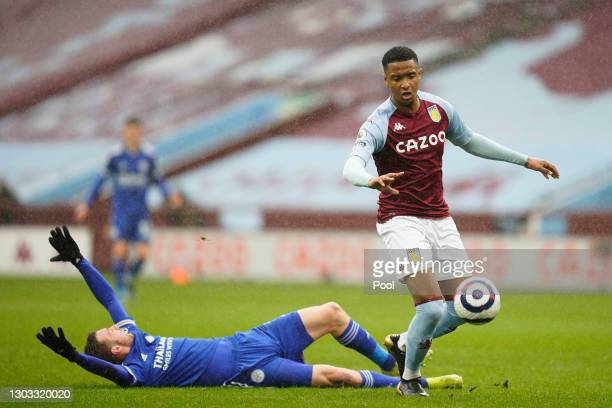 Jamie Vardy of Leicester City reacts after being challenged by Ezri Konsa of Aston Villa during the Premier League match between Aston Villa and...