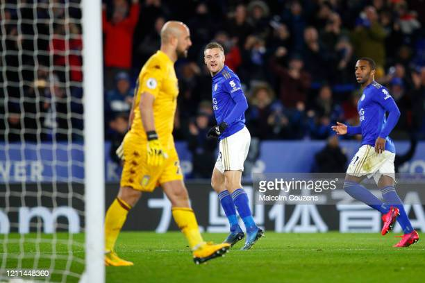 Jamie Vardy of Leicester City reacts towards Pepe Reina of Aston Villa following his goal from the penalty spot during the Premier League match...