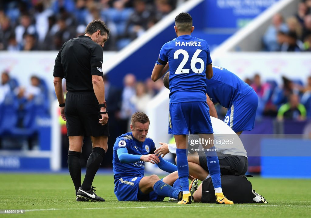 Jamie Vardy of Leicester City receives treatment from the medical team during the Premier League match between Leicester City and Brighton and Hove Albion at The King Power Stadium on August 19, 2017 in Leicester, England.