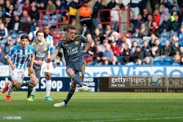Jamie Vardy of Leicester City scores a goal from a penalty during the Premier League match between Huddersfield Town and Leicester City at John...