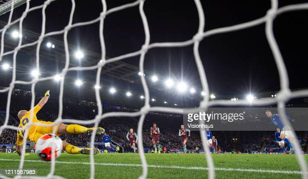 Jamie Vardy of Leicester City scores a penalty past goalkeeper Pepe Reina of Aston Villa during the Premier League match between Leicester City and...