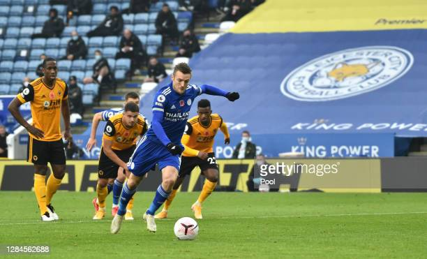 Jamie Vardy of Leicester City scores his sides first goal from the penalty spot during the Premier League match between Leicester City and...