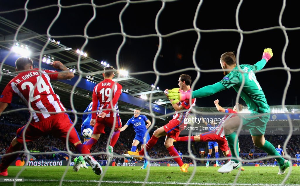 Jamie Vardy of Leicester City (obscure) scores his sides first goal past Jan Oblak of Atletico Madrid during the UEFA Champions League Quarter Final second leg match between Leicester City and Club Atletico de Madrid at The King Power Stadium on April 18, 2017 in Leicester, United Kingdom.