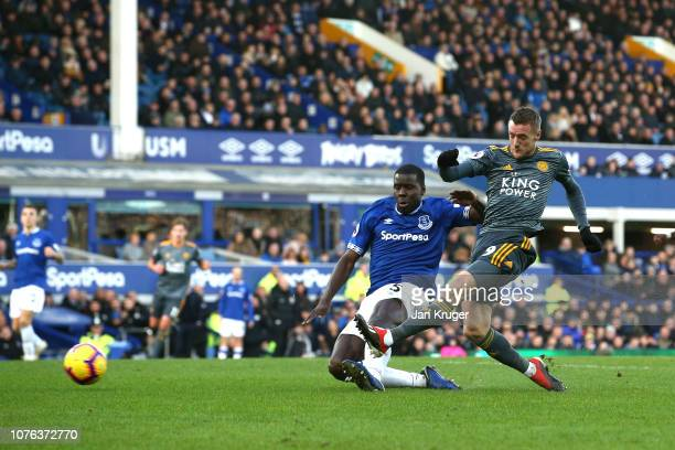 Jamie Vardy of Leicester City scores his sides first goal under pressure from Kurt Zouma of Everton during the Premier League match between Everton...